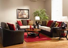 brown leather sofa with colorful cushions added by round brown