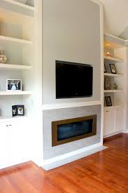 white living room wall unit with built in television and gas