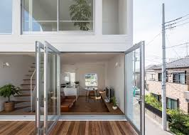 Three Story Houses by Two Patios Cut Through Little House Big Terrace Yamamoto Japan