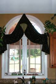 interior black floral patterned arched window valance with half