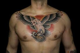 human in claws flying owl on chest