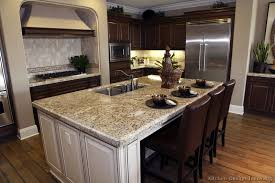 gourmet kitchen island a traditional gourmet kitchen with two tone cabinets and a large