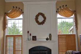 three layers window treatment idea for arched window decofurnish arched window treatment with orange curtain and wooden shutter combination