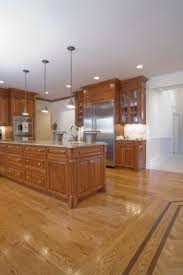 oak kitchen cabinets with oak flooring how to decorate a kitchen with white appliances oak cabinets