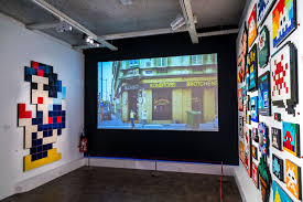 iconic street artist invader invites kids to play his work like