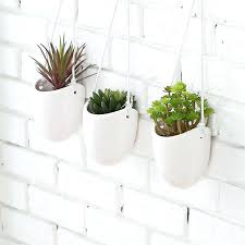 planters that hang on the wall wall mounted planter herb pots garden wall planters metal fence