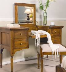 light brown wooden dressing table with four drawers and table on