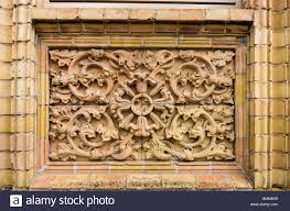 historic exterior architectural detail with tendril ornamentation