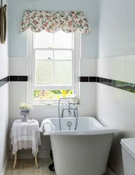 cottage bathroom with slipper bath and window