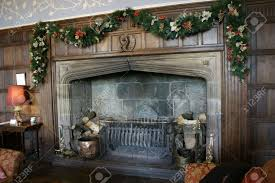 large majestic fireplace decorated for the christmas season stock