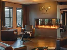 custom 3 sided peninsula gas fireplace in cigar lounge acucraft