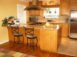 quartz countertops with oak cabinets peninsula kitchen improvers
