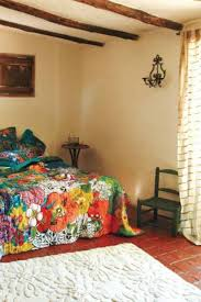 southwestern style homes bedroom with floral bedding and lower