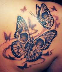 skull in butterfly tattoos on right back shoulder
