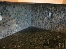 rock kitchen backsplash river rock backsplash river pebble tile kitchen backsplash a diy
