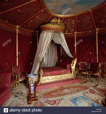 ornate gold coronet with drapes on baroque gold bed in