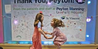 peyton manning s legacy includes the patients he still helps