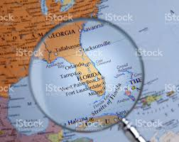 Map Of Fla Magnifying Glass Over A Map Of Florida Stock Photo 459676619 Istock