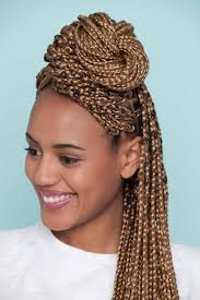 half up half down bun tutorial on box braids