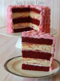 red velvet raspberry swirl cheesecake cake copy say it with cake