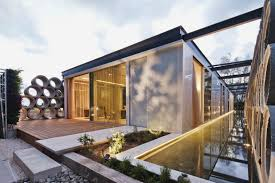 ab home interiors screens made out of concrete pipes provide privacy for this