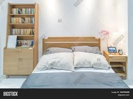 Japanese Style Bedroom by Modern Bedroom Interior With Wooden Bed And Bookshelf In Bedroom