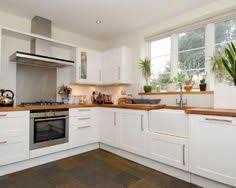 A Double Belfast Sink Is The Ideal Choice For This Classic Country - Kitchen with belfast sink