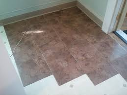 applying stick on floor tiles design