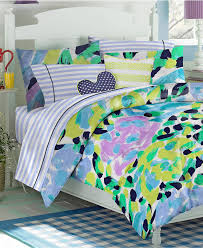 Girls Striped Bedding by Green Purple Yellow And Blue Pattern Bedding Bed On White Wooden