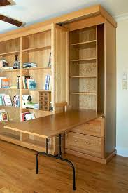 craft cabinet with fold out table absolutely design fold out tables modest ideas fold out table and