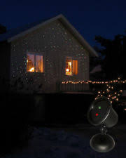 lighted green swags and red bow outdoor christmas window