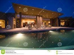 house with swimming pool at night stock photo image 33902240