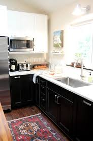 Ikea Kitchen Rugs White Upper Black Lower Cabinets And A Rug That Looks Like Ours
