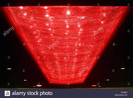 redcolor long illuminated chandelier red color ceiling of big marriage hall