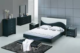 black low bed with grey wall paint decorating in small bedroom