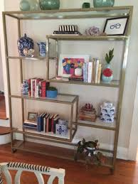 handmade gold bookshelf with glass shelving by five fork studio