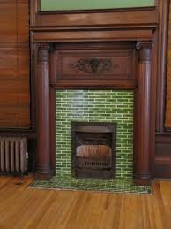 penny tile fireplace eclectic living room by jenn hannotte