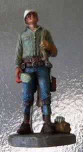 journeyman lineman ornament figurine to the top