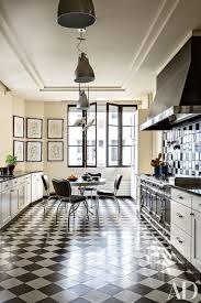 white kitchen cabinets black tile floor 25 black countertops to inspire your kitchen renovation