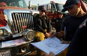 California Wildfire Rocky Fire by Beale Responds To Wildfire With Local Community Firefighters