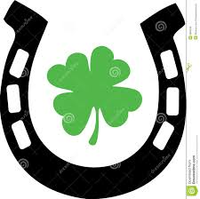 good luck horse shoe and shamrock royalty free stock images