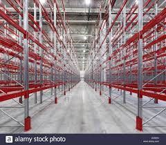 Warehouse Interior by Industrial Racks Pallets Shelves In Huge Empty Warehouse Interior