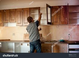 carpenter working on new kitchen cabinets stock photo 43156006