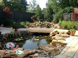 Backyard Pond Building Landscaping And Outdoor Building Raised Ponds Stone Raised Ponds