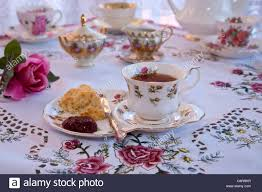 table setting pictures english high tea with scones and jam at a table setting stock