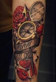 red roses and lovely compass tattoo on arm tattoomagz