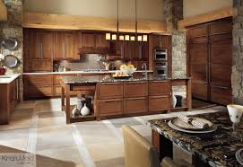 KraftMaid Birch Raised Door In Cognac Rustic Kitchen - Cognac kitchen cabinets