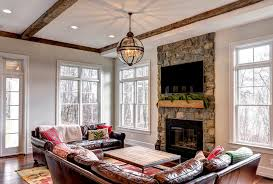 Traditional Family Room With Rock Fireplace By Don Farinelli - Traditional family room