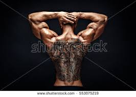 unrecognizable muscular man tattoo on back stock photo 553075234