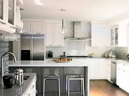 minimalist kitchen design with grey island and white cabinet set